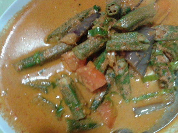 A delicate fresh fish, cooked in a thin curry broth with lady fingers and chili. Wonderful!