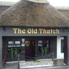 Thatched roof pub next door.