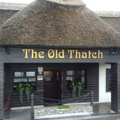 Thatched roof pub next door.